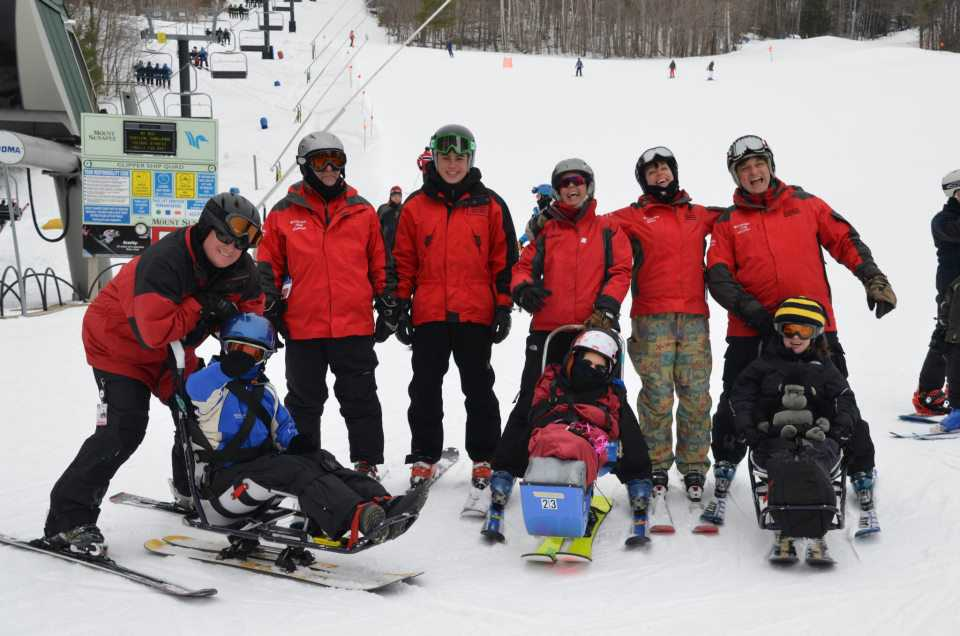 volunteers with sit skis